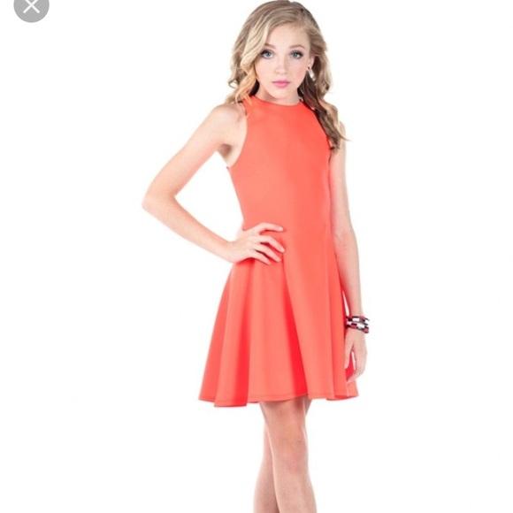 4bad7f6089f Miss behave Girls orange dress with back cut outs.  M 5b8ccf31f414522b7e5e29f9